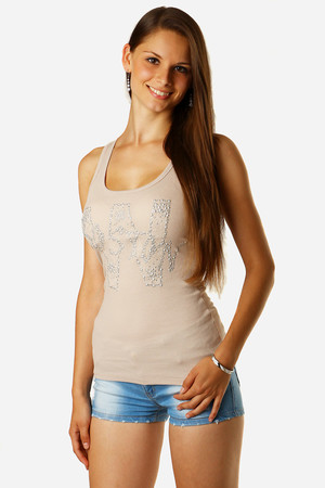 Women's tank top decorated with inscription made of silver stones and beads. Back panel with lace inset. Material: 95%