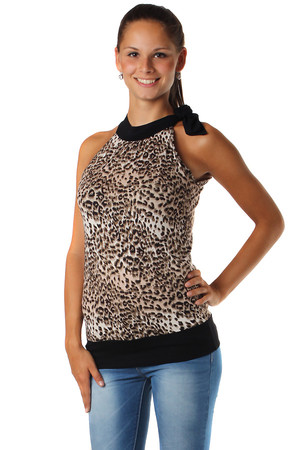 Interestingly designed ladies top in various colors. Shouldering on the shoulder. Monochrome and patterned design. Round