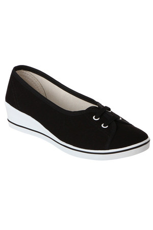 Stylish black ballerinas on lap. Material: upper, insole from textile lining.