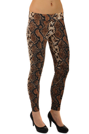 Extravagant ladies leggings with snake pattern and flint application. Material: 65% cotton, 30% polyester, 5% elastane