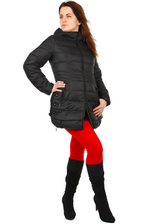 Longer quilted winter jacket with hood. Longer cut, slightly widened underneath. It can be unfastened on the sides. Zip