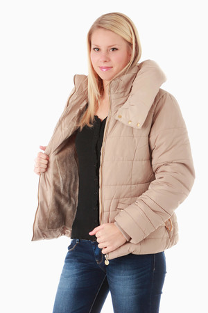 Women's quilted one color jacket with double collar. The large outer collar can be closed and closed with patents. The