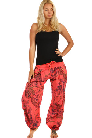 Stylish loose pants with an interesting pattern. Decorated with buttons on the side of the pocket. Tied ribbon at the waist.