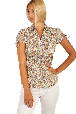 Elegant ladies blouse with floral print and ruffles. Material: 100% cotton.