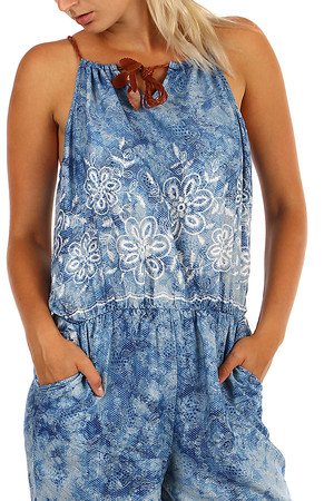 Long ladies loose overall printed with flowers. Adjustable straps. Material: 100% rayon.