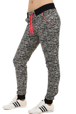 Comfortable women's brindle tracksuit. Rubber at the waist and at the end of the leg. Material: 98% cotton, 2% elastane