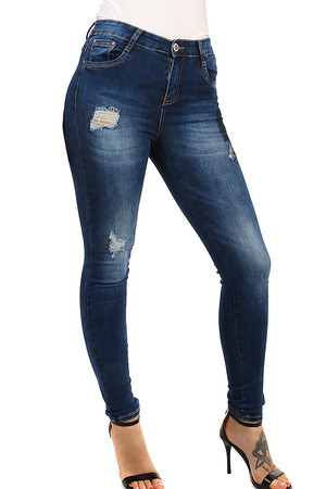 Dark women's jeans with tattered effect and scratching. High waist. Material: 75% cotton, 23% polyester, 2% elastane.