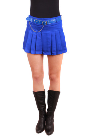 Ladies' short skirt with folds and a belt that is decorated with a chain. Zippered skirt fastening on the side. Import: