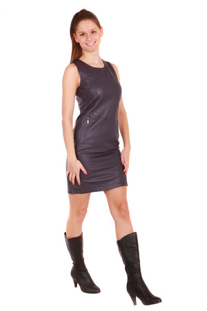 Women's dress in artificial leather. Zip fastening at the back. On the sides of the pocket and a small slit at the back. At