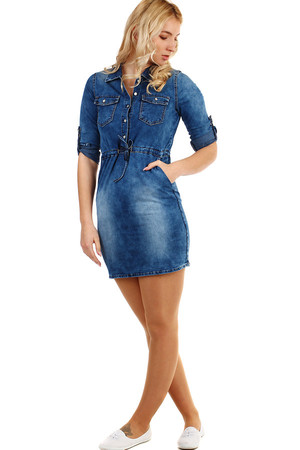 Women's denim dress with squeezing. Sleeves can be worn long or three-quarter, fixed with a button. The shade of the dress