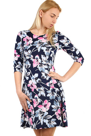 Ladies dress with print and three-quarter sleeve. Effective crossed ribbons on the back. Material - flexible, lightweight,