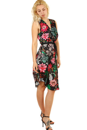 Summer women's dress with a distinctive floral pattern. Ribbon on the waist. The bottom hem is slightly asymmetric. Material