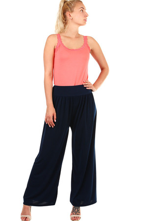Women's monochrome palazzo pants. Material: 95% viscose, 5% elastane. Import: Italy