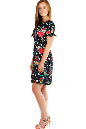 Women's short summer dress with floral pattern. Decorative binding on the sleeves, at the waist and at the neckline rubber.