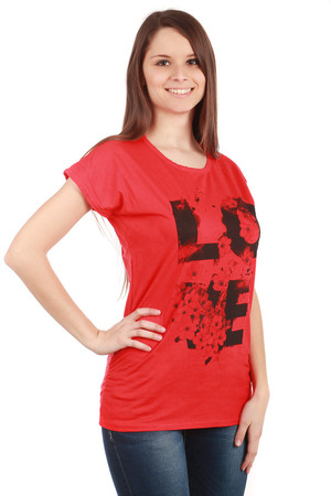 Women's T-shirt with distinctive print on the front. The shirt has a round neck and short sleeves. Comfortable loose fit.