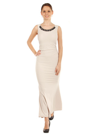 Long dress have a beaded neckline. The back is deeply cut. Import: Italy Material: 95% polyester, 5% elastane