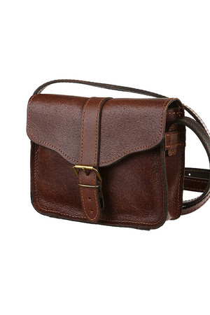 Small crossbody handbag made of genuine leather. can be closed with a flap with a lock with a buckle length adjustable strap