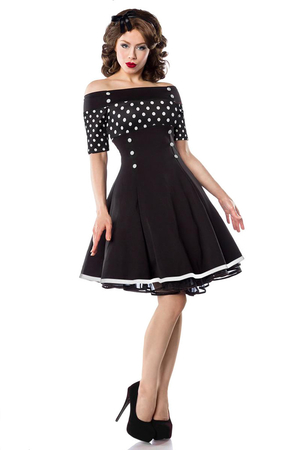 Retro women's dress with bare shoulders black with white polka dots on top and short sleeve décolleté