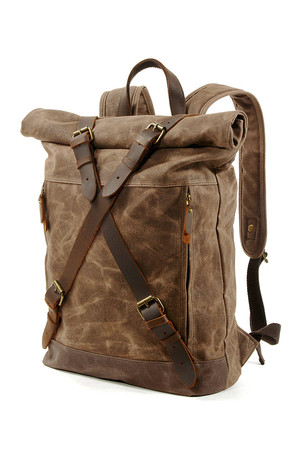 Retro roll-top backpack made of canvas main compartment with a buckle for patents and straps of genuine leather with classic