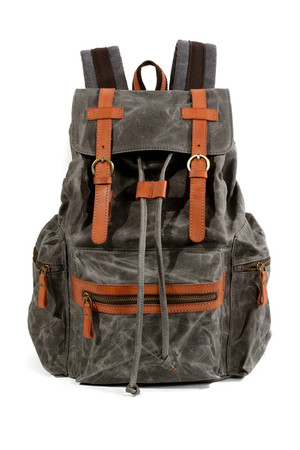 Large retro tourist backpack made of canvas with leather details details, belts of leather the main drawstring compartment is
