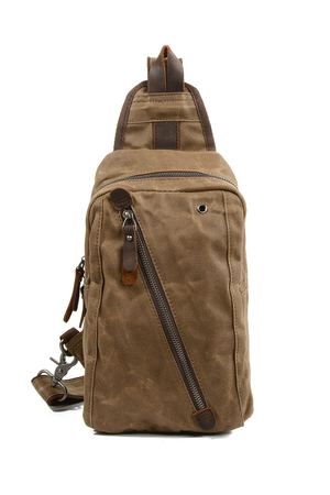 Small canvas backpack on one shoulder with genuine cowhide details the main compartment is zipped inside is a single