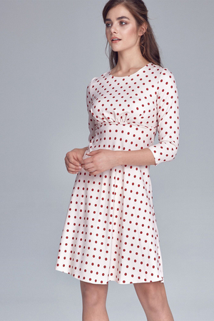 Retro formal women's knee dress with an unoriginal polka dot pattern. three-quarter sleeve round neckline A-cut skirt