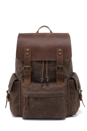 Retro backpack made of waxed canvas interior storage with lining padded tablet or notebook compartment, protected by rubber