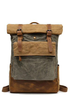 Spacious rolling backpack made of waxed canvas the interior is completely lined reinforced notebook compartment, secured with