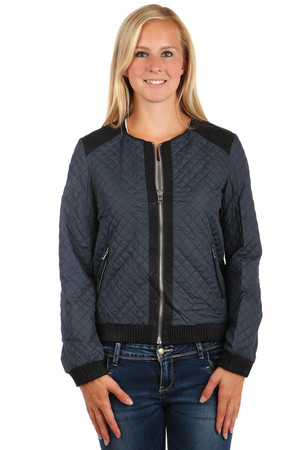 Women's quilted jacket with black trim. Zipped front pockets. Ornament on back. Zip fastening. No hood. Suitable for