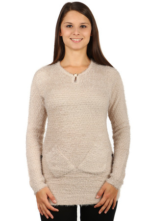 Fashionable warm sweater made of comfortable material. Glossy button in neckline. Two pockets at the bottom. Decorative