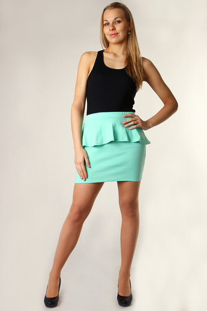 Sporty ladies skirt with frill. Short length and monochrome design with no pattern. Material: 65% polyester, 30% viscose, 5%