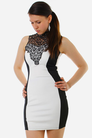 Very elegant women's dress. In black and white. Transparent lace with silver application, changing from chest to back,