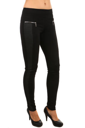 Beautiful ladies leggings with decorative zippers. Gray bar on the side. Leggings are made of thicker, flexible material -