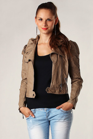 Women's leatherette jacket of original style, frilled collar underlines the extravagant look. Short waist cut, without